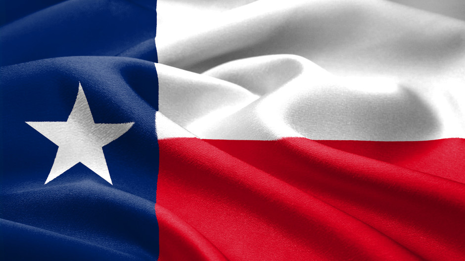 The Texas flag waving in the wind.