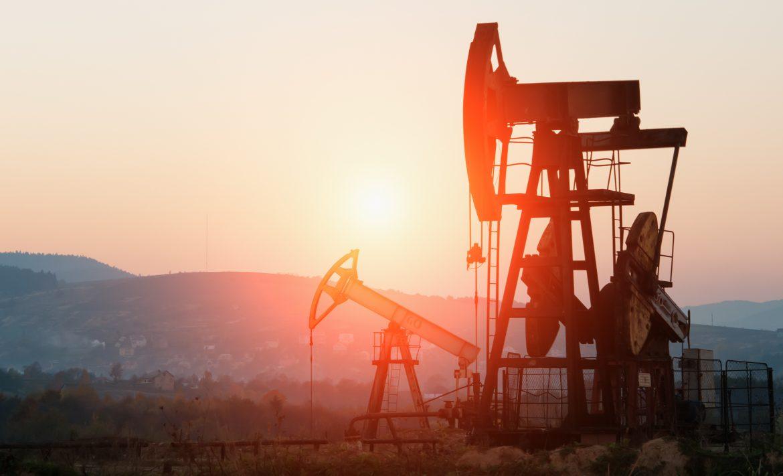 oil pump jack on orange sunset