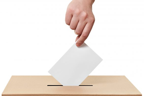 close up of a ballot box and casting vote on white background