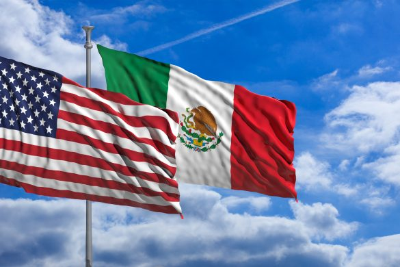USA and Mexico waving flags on blue sky background . 3d illustration